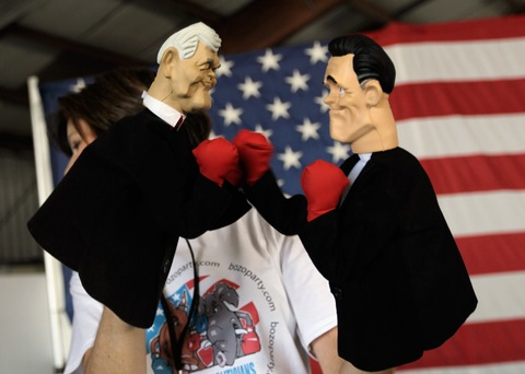 Hand puppets of Newt Gingrich and Mitt Romney; photo by Joe Raedle/Getty Images