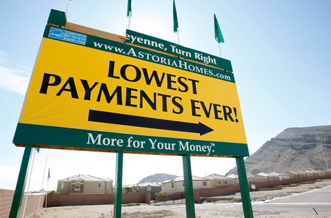 A sign at a new housing development advertises low payments