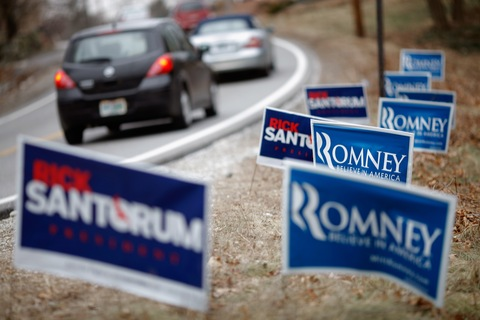 Romney, Santorum signs; photo by Chip Somodevilla/Getty Images