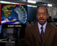 News Wrap: Greece Secures Record Debt Writedown