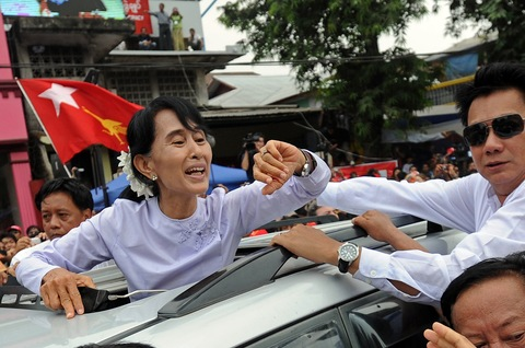 Myanmar opposition leader Aung San Suu Kyi waves to a crowd after speaking to journalists and supporters on Monday in Yangon; Soe Than WIN/AFP/Getty Images