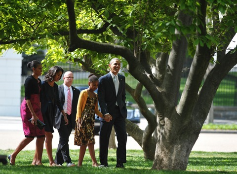 President Obama and the first family; photo by Mandel Ngan/AFP/Getty Images