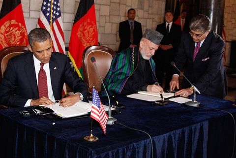 President Obama and Afghan President Hamid Karzai; Afghan Presidential Palace photo via Getty Images