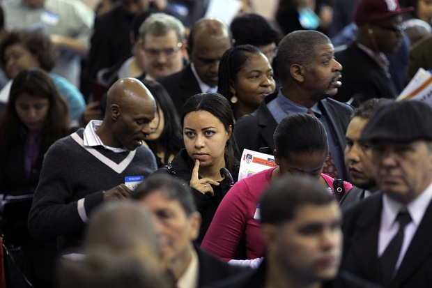 People wait in line at a job fair in the Queens borough of NYC.