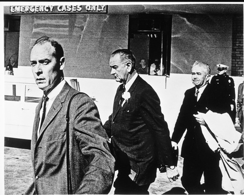 LBJ leaves Parkland Hospital after the death of JFK. Secret Service Agent Rufus Youngblood is at left, and Rep. Homer Thornberry is at right.