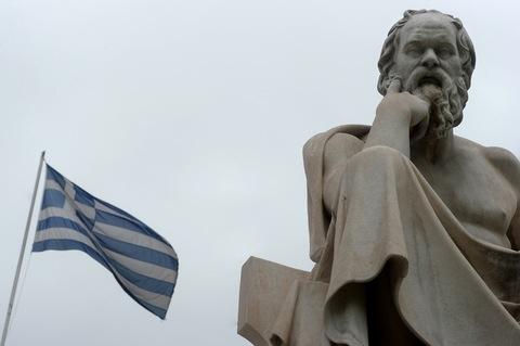 A Greek flag flies and Greek philosopher Socrates