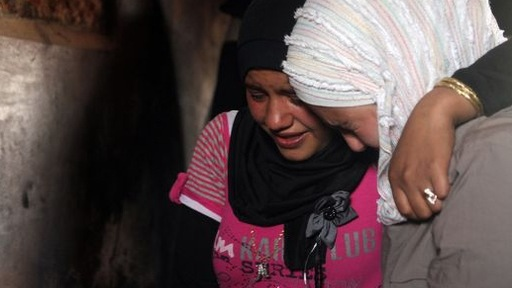 Taimaa and Shimaa Abbous mourn the death of their father in Syria. Photo by Tracey Shelton.
