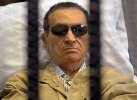 Former Egyptian President Hosni Mubarak in a courtroom in Cairo. Photo by AFP/Getty Images