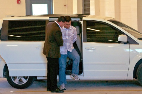 George Zimmerman steps out of a van at the Seminole County Jail in Florida; photo by Roberto Gonzalez/Getty Images