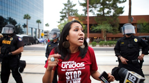 A protester rallies against the Arizona law in Phoenix Monday. Photo by Jonathan Gibby/Getty Images
