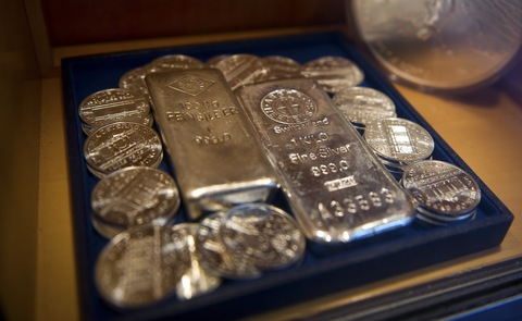 Silver coins and bullion bars sit on display in the window of a Bankhaus Schelhammer & Schattera AG bank branch in Vienna, Austria. Photographer: Akos Stiller/Bloomberg via Getty Images