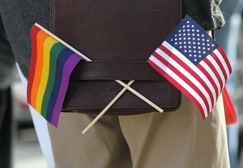 A gay pride and an American flag; photo by Justin Sullivan/Getty Images