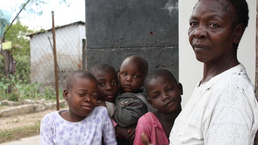 Stella Manyando looks after four of her grandchildren, one of whom is living with HIV. Photo by Annie Mpalume.