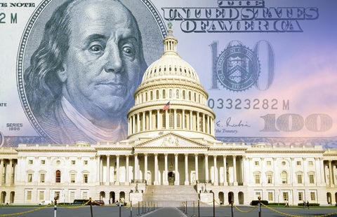 US Capitol with one hundred dollar bill
