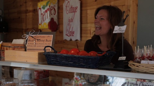 Sara McGuire of Royal Farms at her market stand in Ellsworth, Mich. NewsHour Photo by Michael Werner