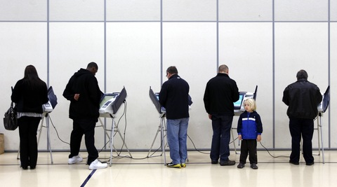 Voters in New Jersey; photo by Matt Sullivan/Reuters