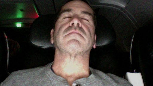 Despite having to pen this blog, Miles O'Brien tries to get some sleep on Virgin America flight 366 on Wednesday. Photo by Miles O'Brien