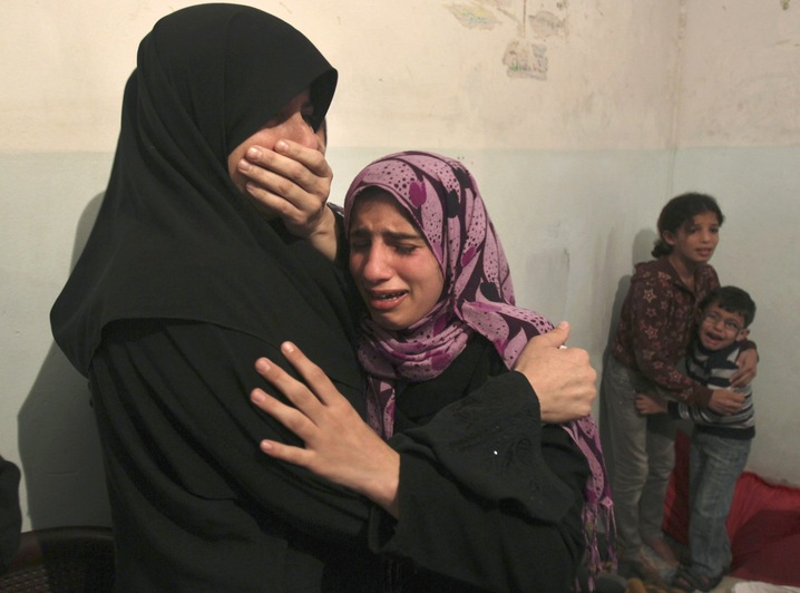 Women Weep for Shelling Victim