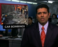 News Wrap: Suicide Car Bombers Kill Dozens in Damascus Suburb