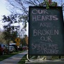 Makeshift Memorials, Flags at Half-Staff Mark State of Mourning in Newtown