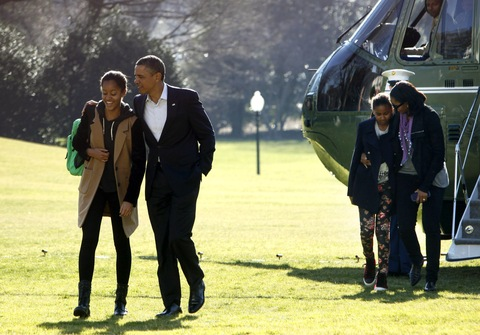 The Obamas; photo by Dennis Brack/Pool via Getty Images
