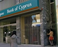 In Cyprus, Banking Crisis Prompts Government to Tax Citizen Savings