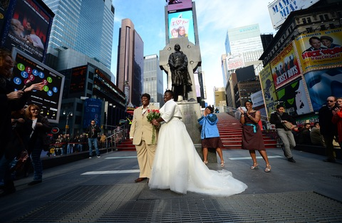 Wedding photo in Times Square; photo by Emmanuel Dunand/AFP/Getty Images