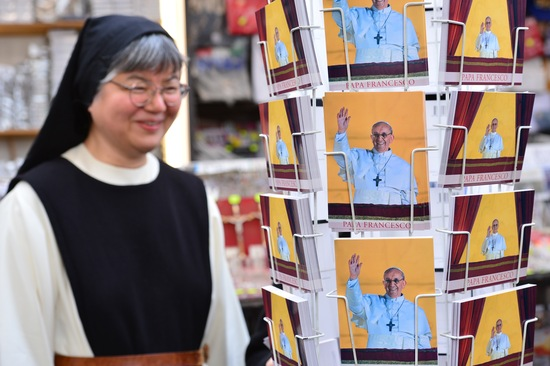 Postcards of Pope Francis; photo by Giuseppe Cacace/AFP/Getty Images
