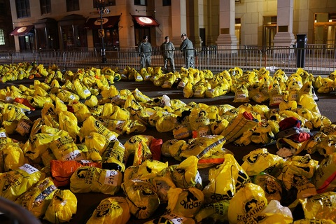 Unclaimed finish line bags at the Boston Marathon; photo by Spencer Platt/Getty Images