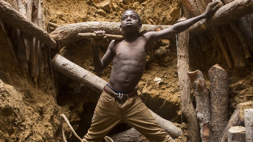 Nine-year-old Karim Sawadogo works with his uncle at a gold mine. Photo by Larry Price.