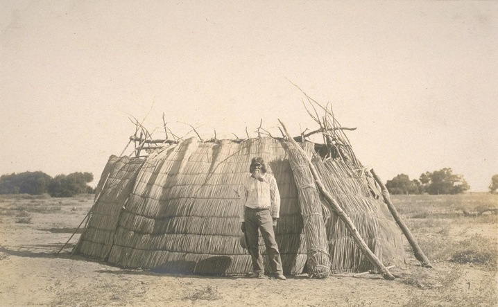 Man with a Tule House