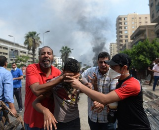 IN PHOTOS: Dozens Killed as Egyptian Forces Clear Our Pro-Morsi Camp